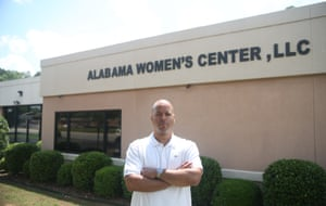 Alabama Women's Clinic owner Dalton Johnson stands in front of his new building, which reopened last October after temporarily closing down last year to move to a new location and make facility upgrades.