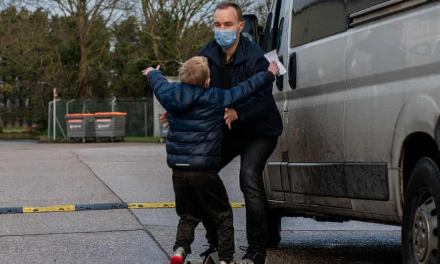 Tom Hayes is greeted by his son after being released from Ford open prison in West Sussex.