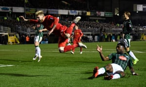 Plymouth Argyle's Yann Songo'o fells Liverpool's Alberto Moreno and the ref points to the penalty spot.