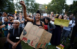 Supporters of the UK branch of Black Lives Matter take part in a demonstration in London