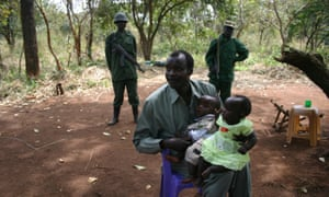 Lord's Resistance Army leader Joseph Kony holds his daughter, Lacot, and son, Opiyo