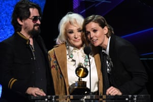 "US musician Tanya Tucker (C), with US singer-songwriter Brandi Carlile (R), accepts the award for Best Country Album for ""While I'm Livin'"" during the 62nd Annual Grammy Awards."