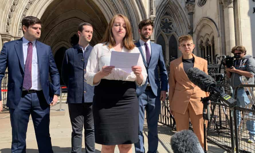 The Labour party whistleblowers outside the high court in London. Martha Robinson reading statement. Back row left to right: Dan Hogan, Ben Westerman, Sam Matthews, and Louise Withers Green