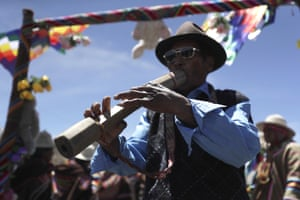 A musician plays his instrument during Morales' homecoming journey