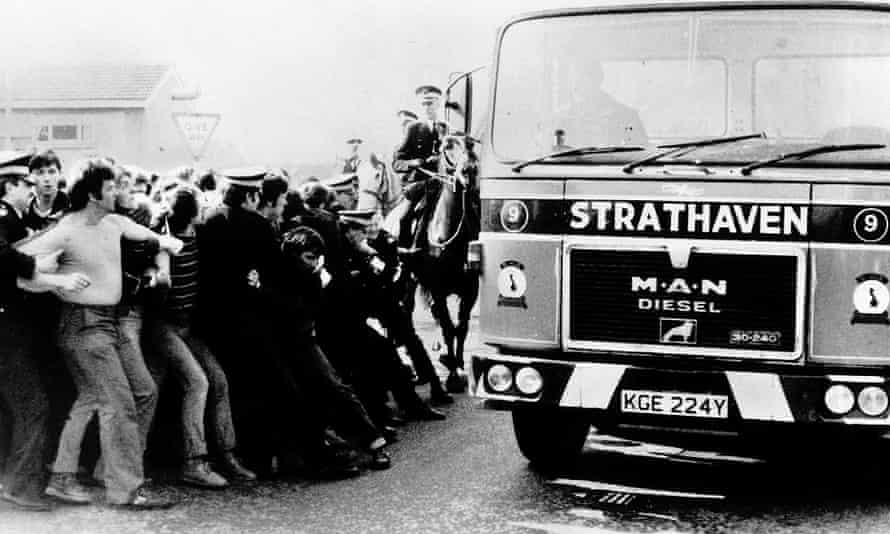 Police hold back picket-line protestors to let through a lorry carrying coal during the 1984 miners' strike