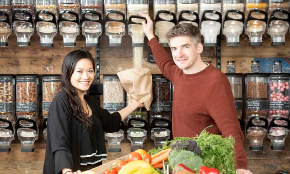 Jeanette Wong and Tom Pell the co-founders of the Clean Kilo, a zero waste supermarket in BirminghamPics - Adrian Sherratt - 07976 237651 Observer - 'Food Monthly'. Jeanette Wong and Tom Pell the co-founders of the Clean Kilo, a zero waste supermarket in Birmingham (2 Apr 2019). - Pouring organic Millet Flakes.