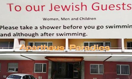 The sign asking Jewish guests to take a shower, and the entrance of the hotel in Arosa, Switzerland