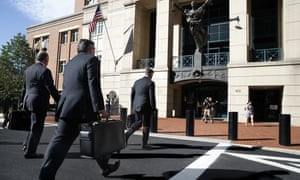 Members of the defense team for Paul Manafort walk to the federal courthouse in Alexandria, Virginia Tuesday.