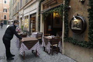 Rome, Italy A waiter sets a table in an outdoor space of a restaurant as Italy gradually reopens after six months of rotating lockdowns