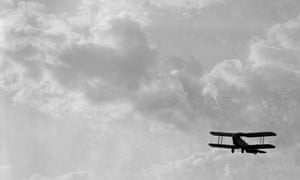 a 1920s biplane in flight.