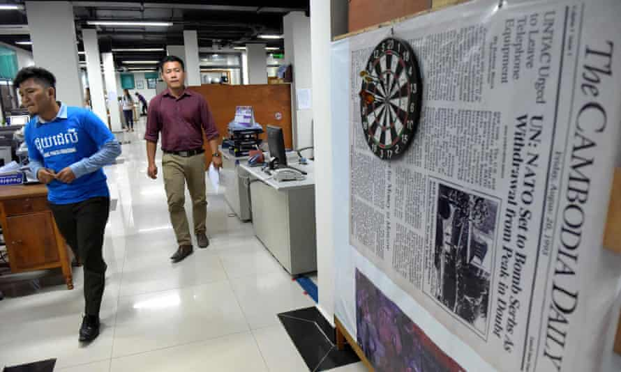Reporters at the English-language newspaper Cambodia Daily shortly before it was due to close.