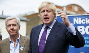 Boris Johnson, right, campaigning to support Nick de Bois, left, Conservative parliamentary candidate for Enfield North