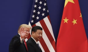 US president Donald Trump waves next to Chinese president Xi Jinping in front of the two nations' flags