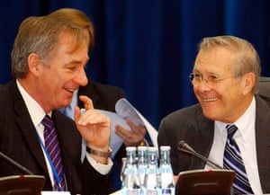 Defence secretary Donald Rumsfeld and defence secretary Geoff Hoon, attend an informal NATO ministers meeting in Poiana Brasov, Romania in 2004.
