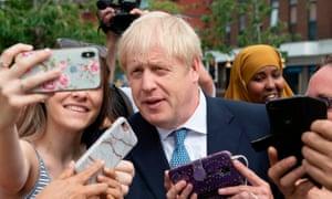 Boris Johnson poses for a selfie in Birmingham on Friday