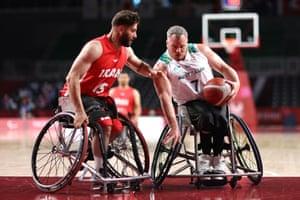 Shaun Norris of Australia battles with Iman Bagzadhfard of Iran during their Wheelchair Basketball Men's preliminary round group B match.