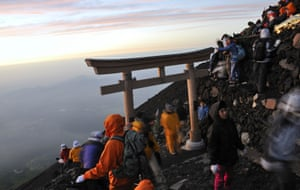 Traditionally Japanese hikers climb Fuji by night to watch sunrise from the summit.