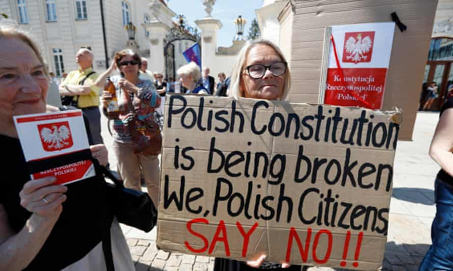 Protesters against the supreme court changes in front of the Presidential Palace in Warsaw.