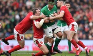 It takes three Welsh defenders to stop CJ Stander