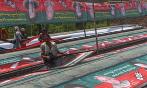 Election banners featuring images of Imran Khan.