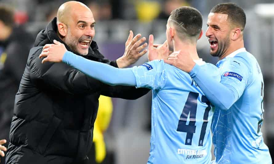 Manchester City manager Pep Guardiola with Kyle Walker (right) and Phil Foden.