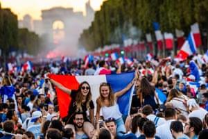 People celebrate on the Champs-Élysées