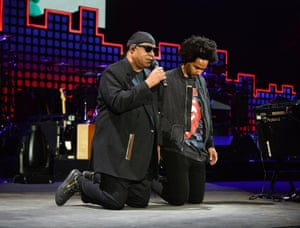 "Stevie Wonder and his son Kwame Morris ""taking a knee for America"" during the 2017 Global Citizen festival in Central Park to end extreme poverty by 2030."