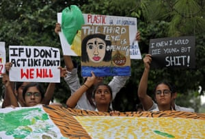New Delhi, India Students display placards during a Fridays for Future march in New Delhi