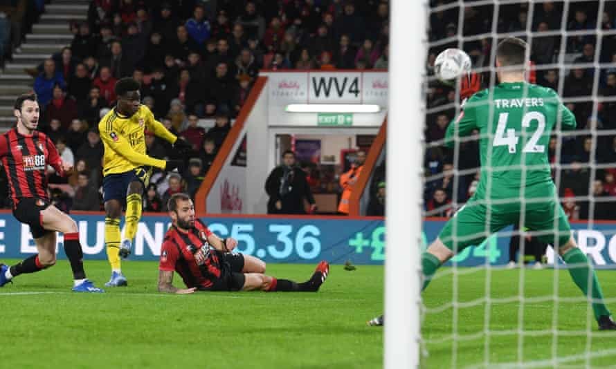 Bukayo Saka scores for Arsenal against Bournemouth in the FA Cup.