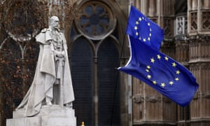 The EU flags wave next to the statue of King George V in Westminster, London