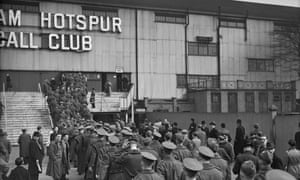 British soldiers queue outside White Hart Lane before a match between Arsenal and Chelsea in 1940.