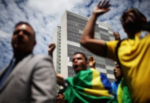 Anti-government demonstrators protest outside the National Congress building in Brasilia, Brazil.