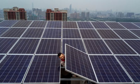 A man works on a solar panel project in Wuhan, China.