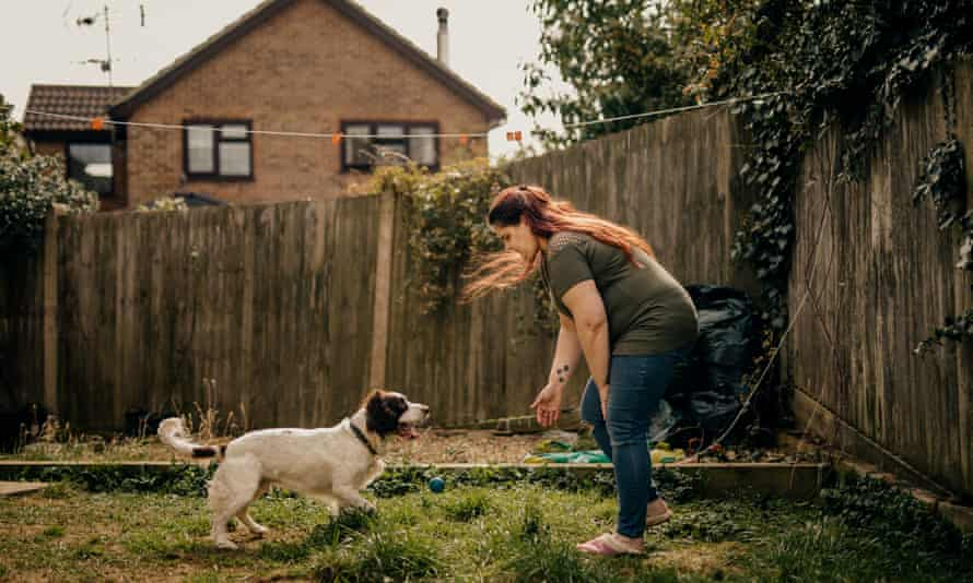Donna Botting with her dog Ronnie in her back garden