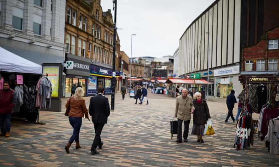 Shoppers walk through Barnsley town centre