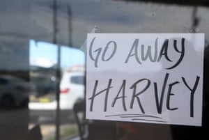 A sign encouraging Hurricane Harvey to leave the Gulf of Mexico area is placed in JB's German bakery and cafe