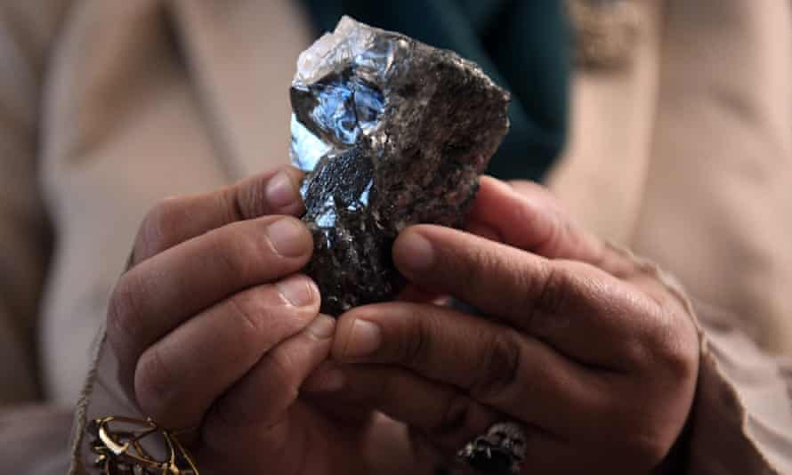 A member of the Botswana cabinet in Gaborone holds the 1,174-carat diamond