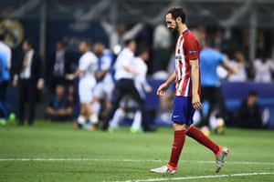 Juanfran looks down as he walks back to the centre.