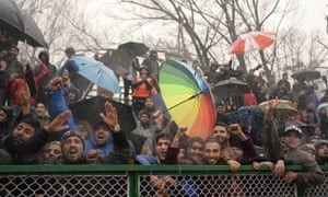 Fans of Real Kashmir cheer during their I-League club football match against Gokulam Kerala FC at the Tourist Reception Centre football ground in Srinagar.