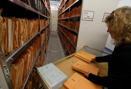 A member of the Stasi Museum shows folders with records gathered by an informer for the secret police.