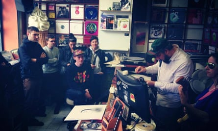 Record buyers in the Doctor Vinyl record shop, Brussels, Belgium.