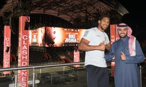 Anthony Joshua poses with Prince Abdulaziz bin Turki Al-Faisal at the final press conference before the heavyweight title fight against Andy Ruiz Jr on Saturday.