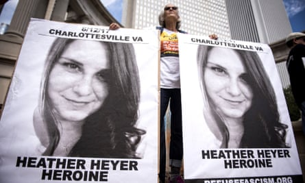 A demonstrator holds signs featuring Heather Heyer at a rally in Chicago on 13 August 2017, the day after she was killed by James Fields at a rally in Charlottesville, Virginia.