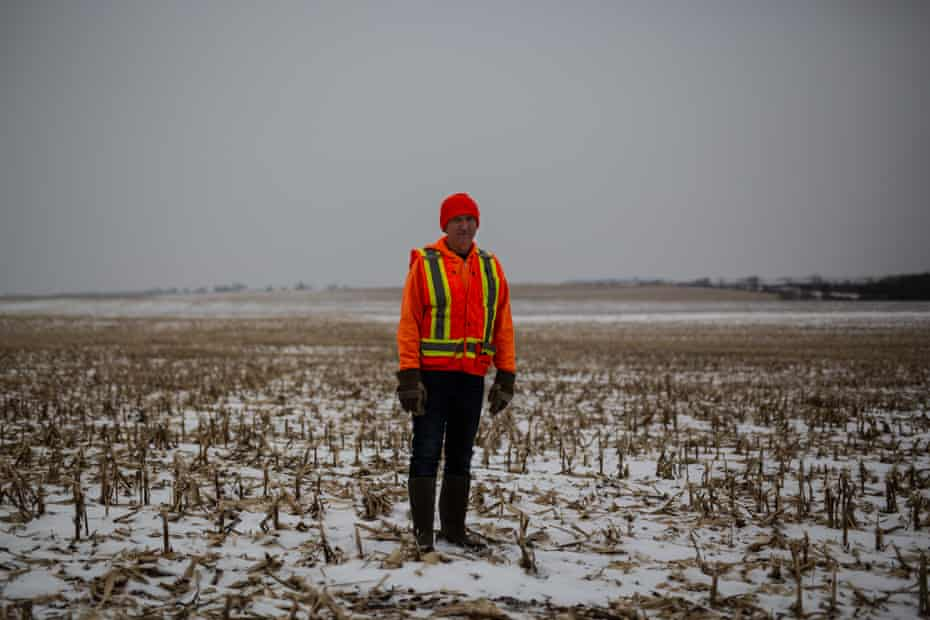 Neil Shaffer posed in the barren fields he used to farm in Cresco, Iowa on Thursday, December 12th. Photo by Jordan Gale