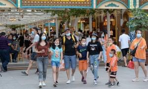 Tourists visit the Grand Bazaar Food Street in Urumqi, the capital city of northwest China's Xinjiang Uighur Autonomous Region, 4 July 2020.