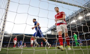 Chelsea's Diego Costa celebrates after opening the scoring as Middlesbrough's Calum Chambers looks deflated.