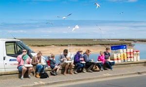 Enjoying fish and chips on the quayside at Wells-next-the-Sea.