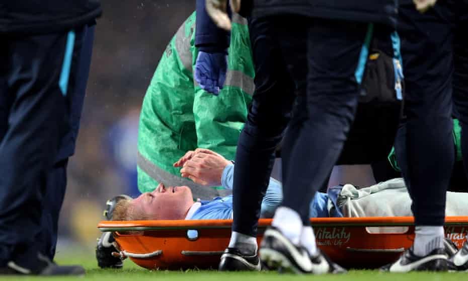 Kevin De Bruyne is laid on a stretcher after injuring his knee.