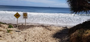 High tides and debris have inundated the main beach of Byron Bay. Felled trees are left on the beach 'to offer some small degree of protection from waves'.