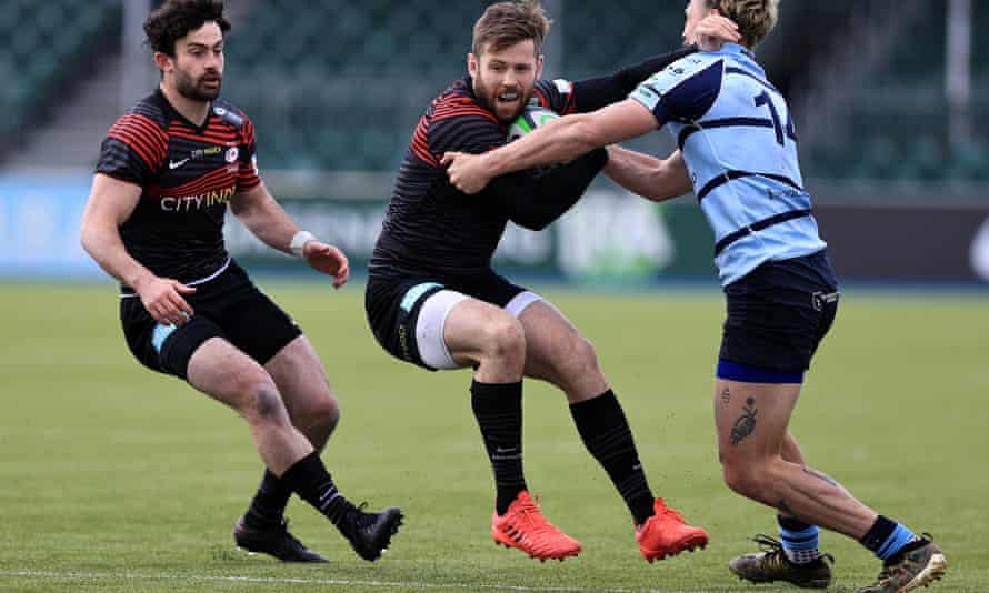 Elliot Daly is held by Bedford's Pat Tapley in Saracens' handsome Championship victory.